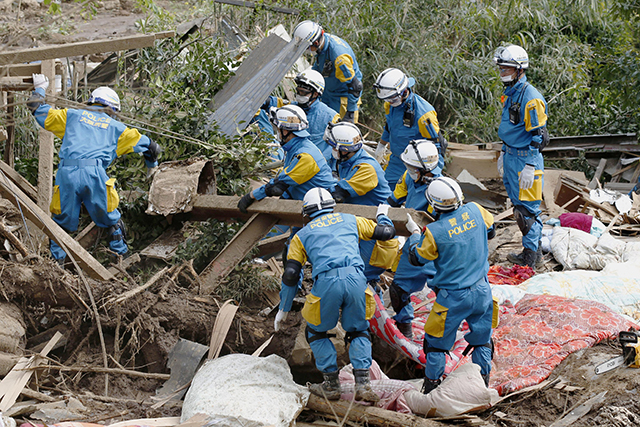 Police officers conduct a search operation near the damaged houses in Minamiaso, Kumamoto prefecture, southern Japan Saturday, April 16, 2016. Powerful earthquakes a day apart shook southwestern Japan, trapping many beneath flattened homes and sending thousands to seek shelter in gymnasiums and hotel lobbies. (Shohei Miyano/Kyodo News via AP) JAPAN OUT, MANDATORY CREDIT