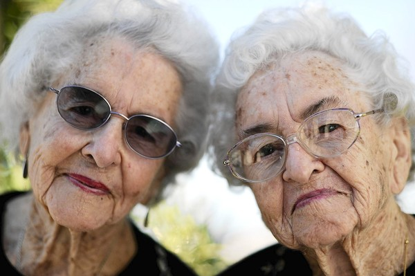 BURBANK, CA-January 12, 2011:  From left, Inez Harries and twin sister Venice Shaw pose for a portrait outside the Lockheed Federal Credit Union on January 12, 2011. The two will celebrate their 100th birthday on Saturday, making the sisters the second oldest female twins in the world. (Mariah Tauger / Los Angeles Times)