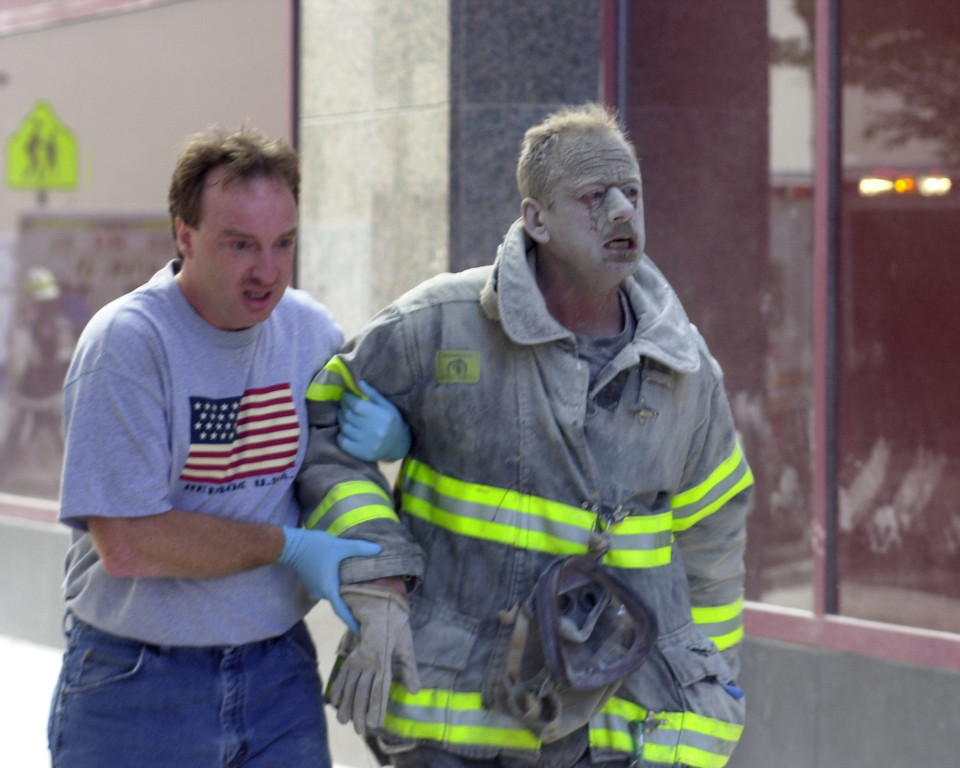 UNITED STATES - SEPTEMBER 11:  Firefighter covered with ash after World Trade Center collapsed in terrorist attack.  (Photo by Thomas Monaster/NY Daily News Archive via Getty Images)