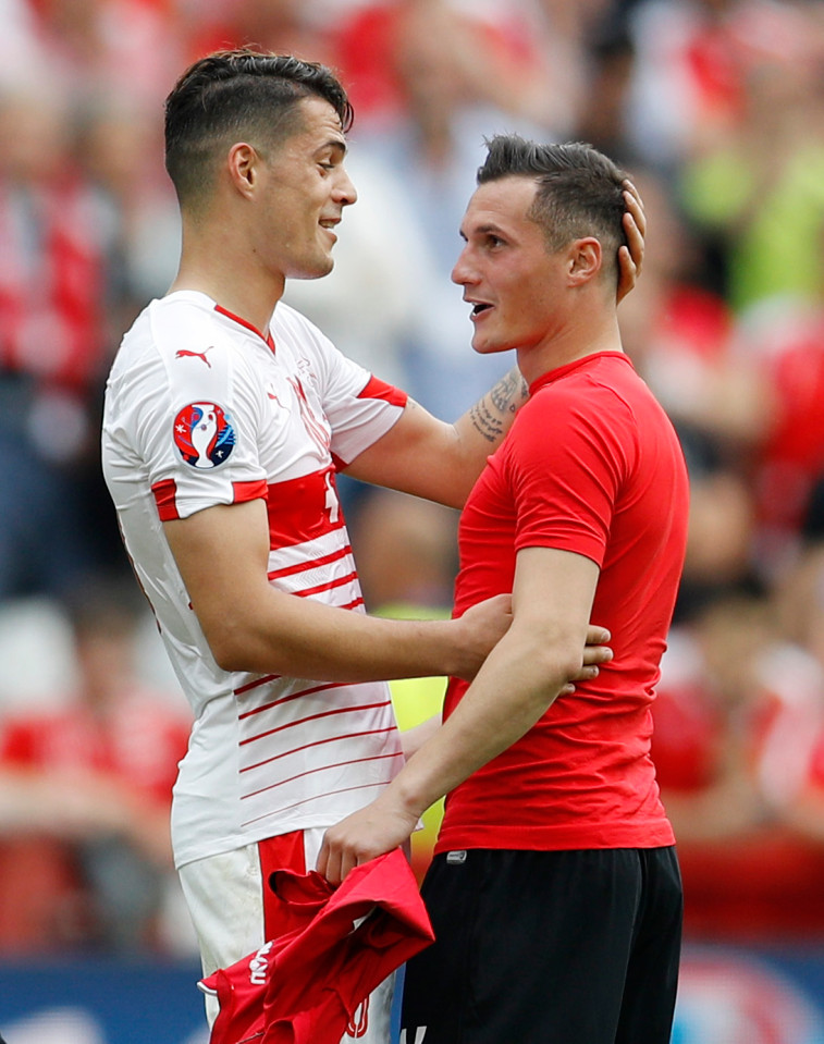 Football Soccer - Albania v Switzerland - EURO 2016 - Group A - Stade Bollaert-Delelis, Lens, France - 11/6/16 Switzerland's Granit Xhaka with his brother Albania's Taulant Xhaka at the end of the game REUTERS/Darren Staples Livepic
