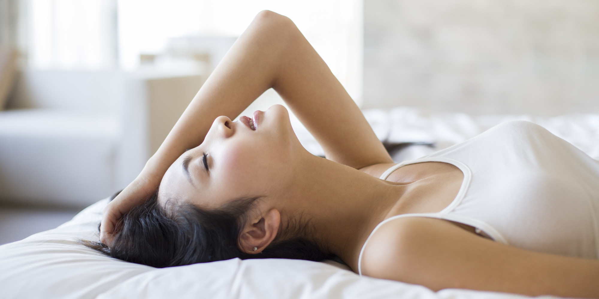 Young woman sleeping on bed