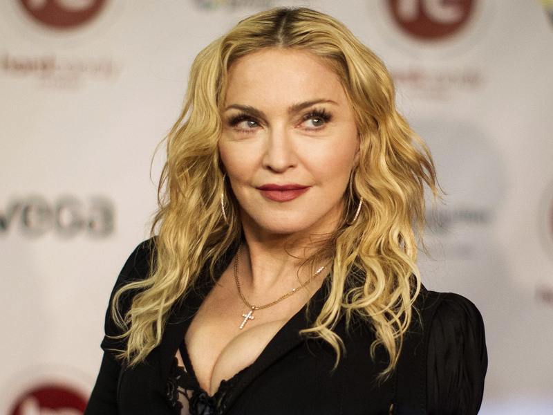 Madonna arrives at the opening of Toronto's Hard Candy Fitness, on Tuesday, Feb. 11 , 2014. (AP Photo/The Canadian Press, Chris Young)