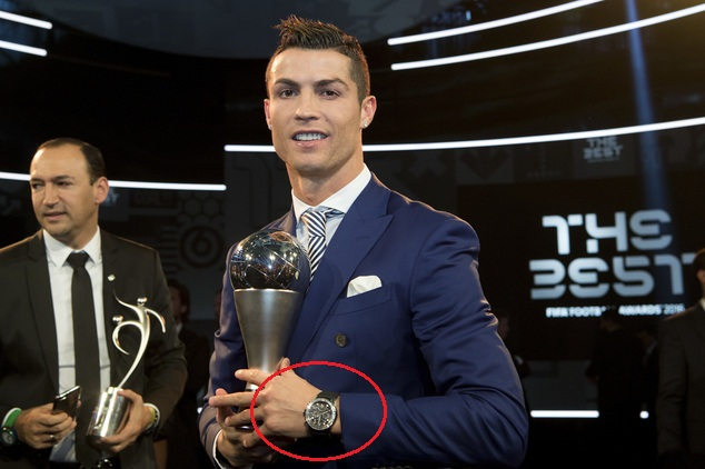 Cristiano Ronaldo of Portugal poses with the trophy after winning for The Best FIFA Men's Player award during the The Best FIFA Football Awards 2016 ceremony held at the Swiss TV studio in Zurich, Switzerland, Monday, Jan. 9, 2017. (Ennio Leanza/Keystone via AP)