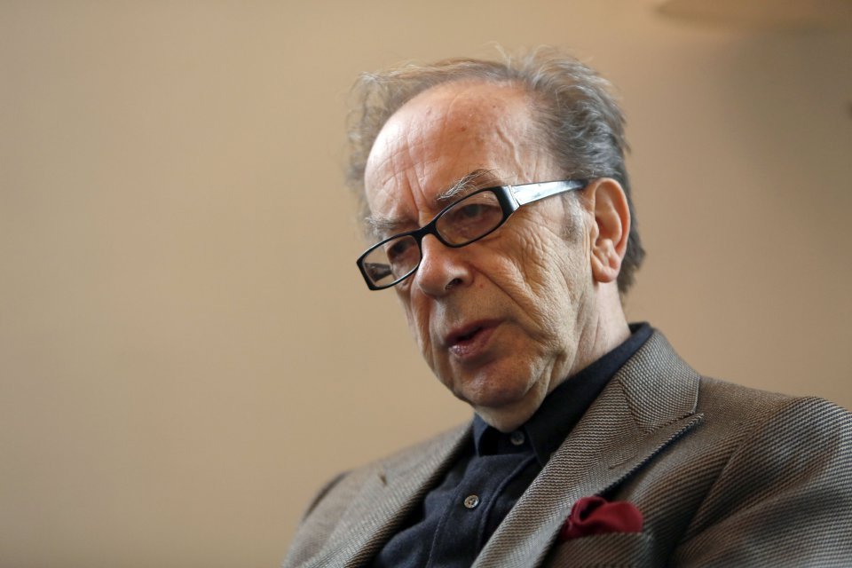 (FILES) This file photo taken on February 08, 2015 shows Albanian novelist Ismail Kadare gestures during an interview with AFP in Jerusalem. The Swedish Academy stunned the world last year when it awarded the Nobel Literature Prize to US counter-culture icon and rock star Bob Dylan. This year, experts say, the laureate will be more conventional. / AFP PHOTO / GALI TIBBON