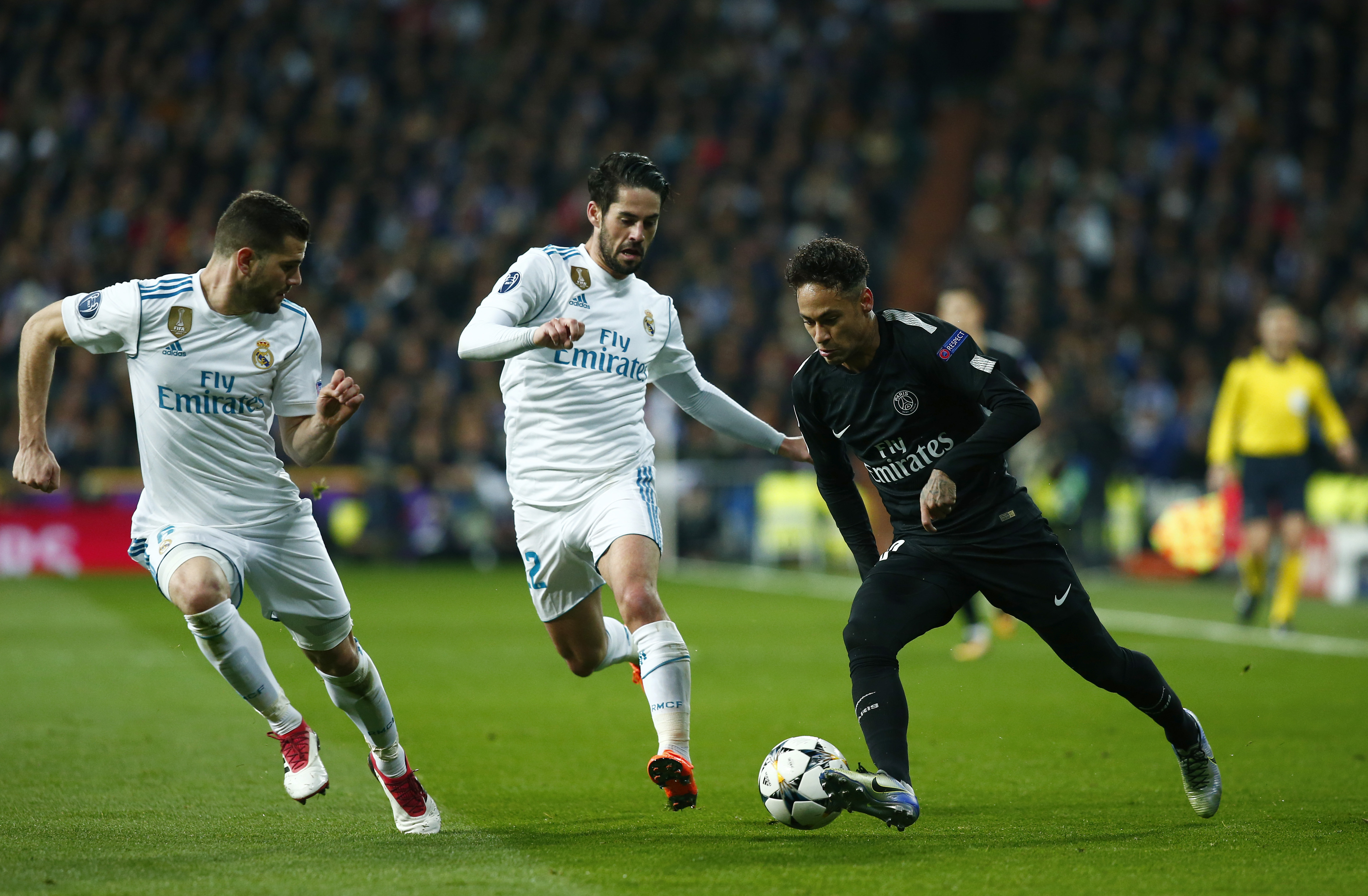 MADRID, SPAIN - FEBRUARY 14:  Nacho Fernandez and Isco of Real Madrid close down Neymar of PSG in action during the UEFA Champions League Round of 16 First Leg match between Real Madrid and Paris Saint-Germain at Bernabeu on February 14, 2018 in Madrid, Spain.  (Photo by Gonzalo Arroyo Moreno/Getty Images)