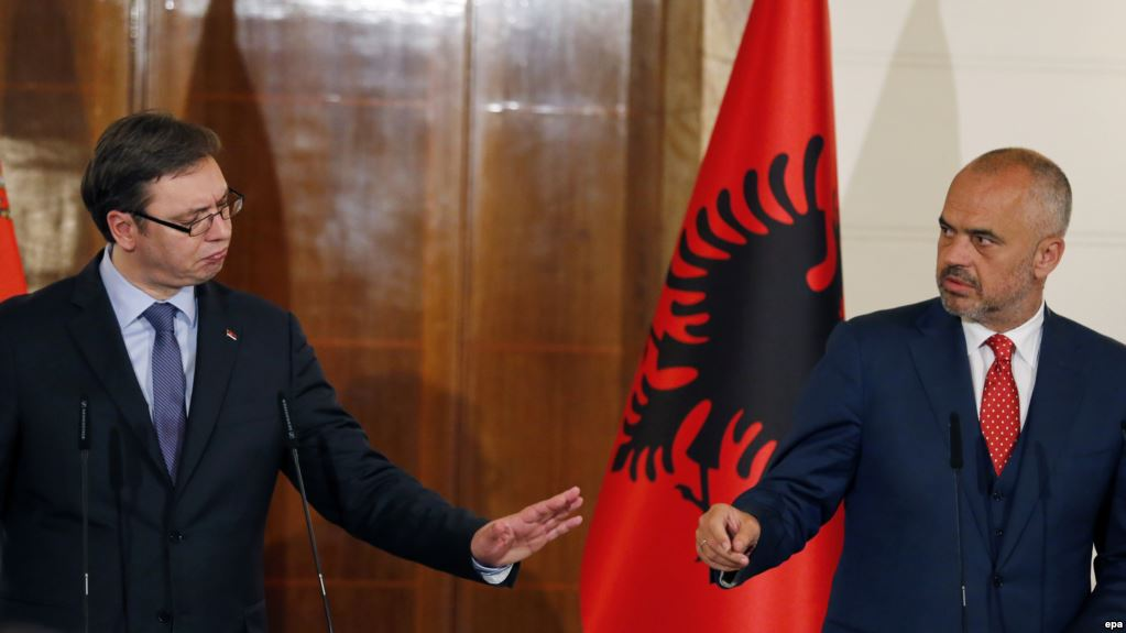 epa04770211 Serbian Prime Minister Aleksandar Vucic (L) react as Albanian Prime Minister Edi Rama (R) looks on during a joint press conference in Tirana, Albania, 27 May 2015. Vucic arrived in Tirana for a two-day official visit on the invitation by his Albanian counterpart.  EPA/ARMANDO BABANI